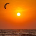 Silhouette of a kitesurfer st sunset Royalty Free Stock Photos