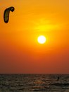Silhouette of a kitesurfer at sunset Stock Photo