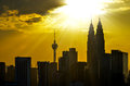 Silhouette of kuala lumpur twin towers during sunset at malaysia asia Royalty Free Stock Photography