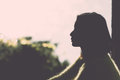 Silhouette of lonely woman portrait young sitting during dusk time Stock Photography