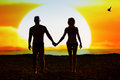 Silhouette of loving couple on the beach at sunset Royalty Free Stock Images