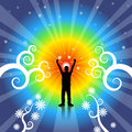 Silhouette of a man with arms up in the air surrounded by a rainbow flare and stars Royalty Free Stock Photography