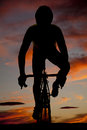 Silhouette man on bike forward a a riding in the sunset or sunrise Royalty Free Stock Photography
