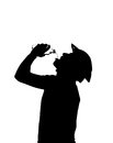 Silhouette of a man drinks water to quench thirst young with mountain bike helmet Royalty Free Stock Photos
