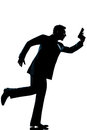 Silhouette man full length running holding gun Royalty Free Stock Photography