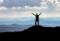 Silhouette of a man on a mountain top. Royalty Free Stock Photo