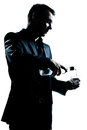 Silhouette man portrait pouring white alcohol Royalty Free Stock Photo