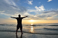 Silhouette of man raising his hands or open arms when sun rising up Royalty Free Stock Image