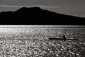 Silhouette of a man sea kayaking