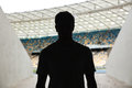 Silhouette of a man standing at the stadium Royalty Free Stock Photo