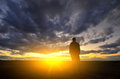 Silhouette of man at the sunset emotional scene Royalty Free Stock Photos