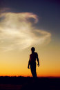Silhouette of man at sunset, follow your dream Royalty Free Stock Photo