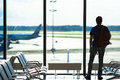 Silhouette of a man waiting to board a flight in Royalty Free Stock Photo
