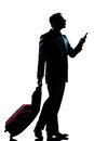 Silhouette man walking on the phone full length Royalty Free Stock Photo