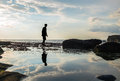 Silhouette, a man walking with reflection on water Royalty Free Stock Photo