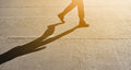 Silhouette of Man walking or stepping with shadow and sunlight Royalty Free Stock Photo