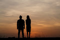 Silhouette man and woman with beautiful the sky at sunset.Backg Royalty Free Stock Photo