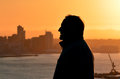 Silhouette of mature man against city skyline during sunset Stock Photography