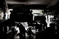 Silhouette of mechanics servicing cars at a small workshop Royalty Free Stock Photo