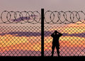 Silhouette of a military border guard Royalty Free Stock Photo