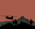 Silhouette of military soldiers team or officer with weapons and tank at colorful background Royalty Free Stock Images