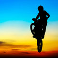 Silhouette of motocross rider jump in the sky Royalty Free Stock Photo