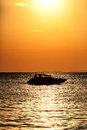 Silhouette of a motor speed boat at sunset Royalty Free Stock Photo
