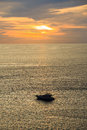 Silhouette of a motor speed boat during sunset. Royalty Free Stock Photo