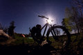 Silhouette of mountain bike at night Royalty Free Stock Photo