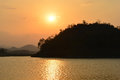 Silhouette mountain with river and sunset. Royalty Free Stock Photo
