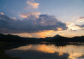 Silhouette mountain and  river in twilight sunset Royalty Free Stock Photo