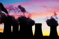 Silhouette of nuclear power plant during sunset atomic Stock Photos