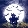 Halloween. Silhouette of an old house and bats on a background of the full moon. Fog, moss Royalty Free Stock Photo