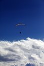 Silhouette of paraglider and blue sky with clouds caucasus mountains georgia view from ski resort gudauri Royalty Free Stock Photo