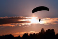 Silhouette paraglider pilot on sky sunset Royalty Free Stock Image