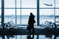 Silhouette of passenger waiting for the flight in airport Royalty Free Stock Photo
