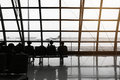 Silhouette of passengers waiting for the airplane Royalty Free Stock Photo