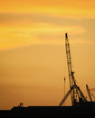 Silhouette people discussing at construction site in the dawn rooftop of Royalty Free Stock Photography