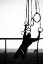 Silhouette of a person swinging on rings the beach santa monica beach santa monica los angeles county california usa Royalty Free Stock Photos
