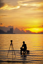 A silhouette of photographer shooting for sunrise Stock Images