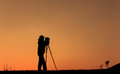 Silhouette of photographer take a photo at the sunset time Stock Image