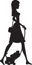 A silhouette in profile of a smartly dressed young woman out for a stroll with a young pup on a leash Royalty Free Stock Photos