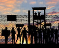 Silhouette protesting refugees near the border