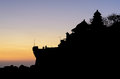 Silhouette of pura tanah lot hindu temple and sunset sky in bali Royalty Free Stock Photo
