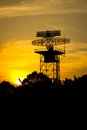 Silhouette radar tower plane on sunset time Royalty Free Stock Photos