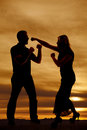 Silhouette ready to fight a of a men and women Stock Photos
