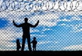 Silhouette refugees father and two children