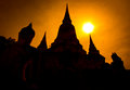 Silhouette ruined pagoda and Buddha statue, Thailand Royalty Free Stock Photo