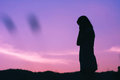 Silhouette of sadness woman standing against sunset Royalty Free Stock Photo