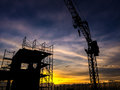 Silhouette of scaffolding in the construction site Royalty Free Stock Photo